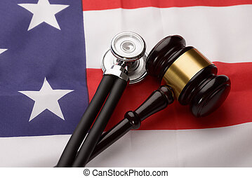 Wooden Gavel And Stethoscope On Usa Flag - Close-up Of...