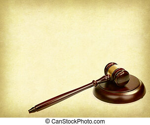 Wooden gavel on old paper background, law concept