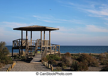 Wooden gazebo on the beach