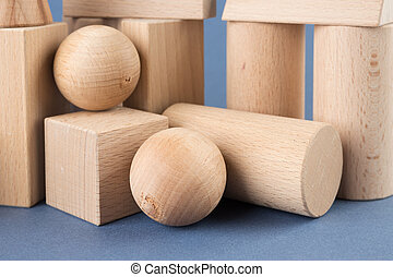 wooden geometric shapes on a blue background