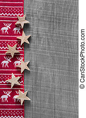 Wooden grey shabby christmas background in red with reindeer.