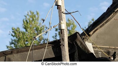 wooden guide of electric wires in the village in summer.