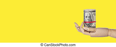 Wooden hand with money isolated on yellow background
