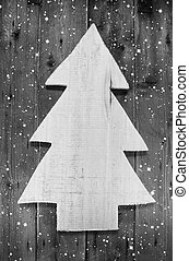 Wooden handmade christmas tree in shabby style on a wood snowy b