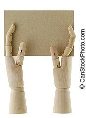Wooden hands holding a piece of blank brown paper