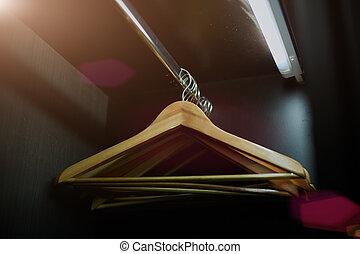 wooden hangers in a closet