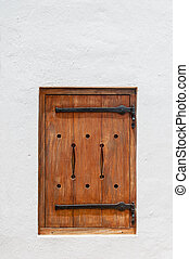 Wooden hatch window in a historic Cape Dutch building