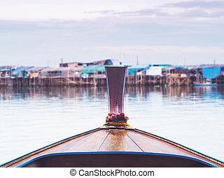 Wooden head longtail fishing boat