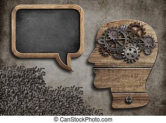 wooden head with speech bubble blackboard