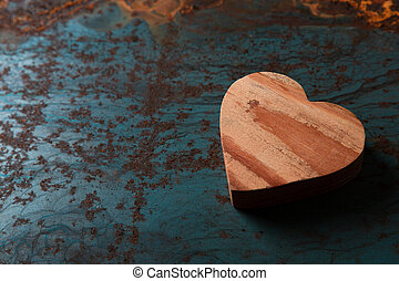 Wooden heart on a metal background with copy space