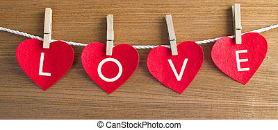 Wooden heart on a red card.