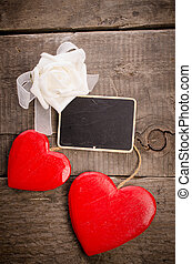 Wooden heart shapes with a blackboard
