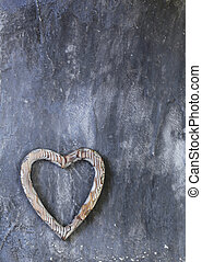 Wooden heart symbol on a gray