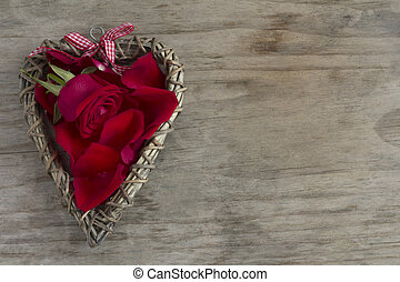 Wooden Heart with Rose and Petals with Copy Space