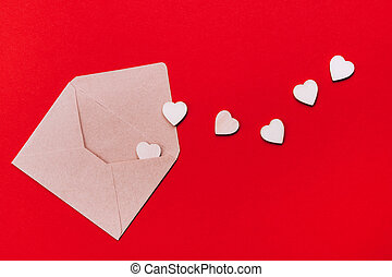 Wooden hearts in an open craft envelope