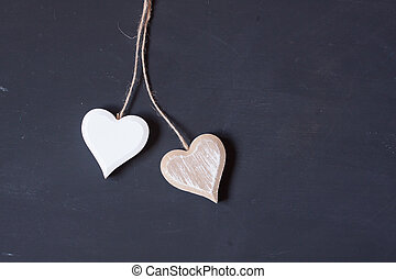 wooden hearts on a black background