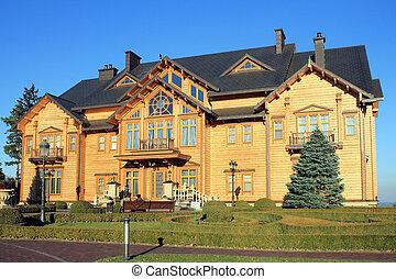 Wooden Honka house in Mezhyhirya, Kyiv region, Ukraine.