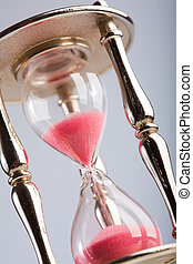 Wooden hourglass  on light background