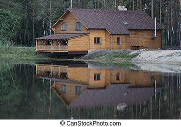Wooden house above the lake