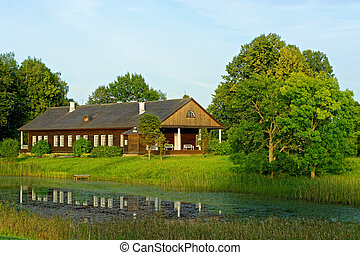 Wooden house by the pond.