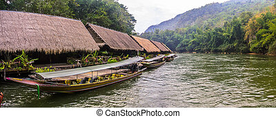 wooden house floating on the river
