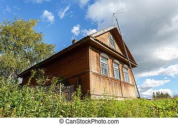 Wooden house in russian village in summer