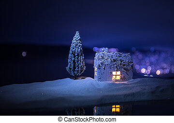 wooden house in winter forest at night