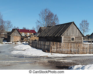 Wooden house in winter village