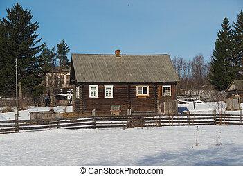 Wooden house in winter village
