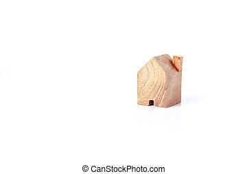 Wooden house model on white background.
