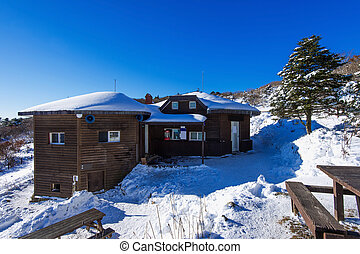 Wooden house on Deogyusan mountains in winter, South Korea.