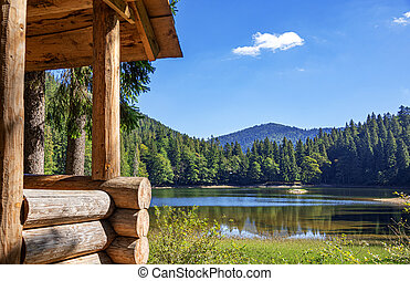 Wooden house on the shore of a picturesque lake.