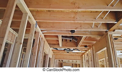 NewYork NY US. 02 MAY 2020: Wooden beam house residential construction home framing