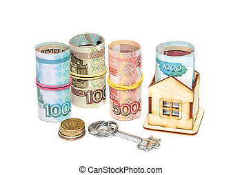 Wooden house, Russian money and key on a white background. Housing costs