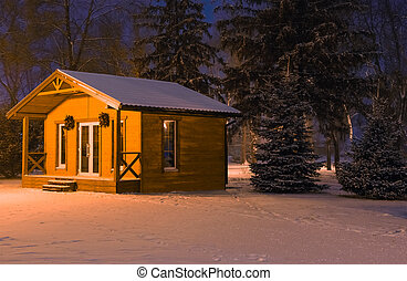 Wooden house Santa Claus night when the snow fell