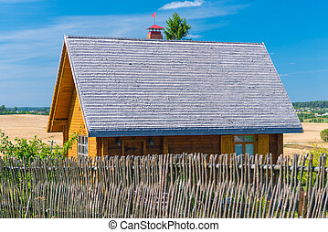 wooden house with a fence in the village