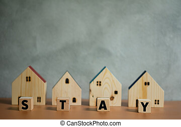 Wooden house with word stay. Safe home for safe life.