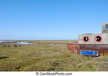 Wooden Houseboat in estuary