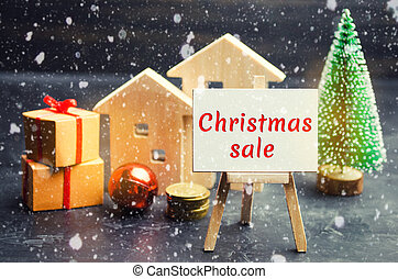 Wooden houses and Christmas tree with the inscription Christmas Sale. Christmas Sale of Real Estate. New Year discounts for buying house. Purchase apartments at a low price. Winter resort and vacation