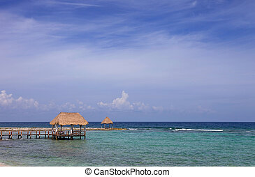 wooden houses at the caribbean sea, yucatan, mexico