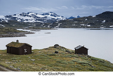 wooden houses at the famous County Road 55 norway