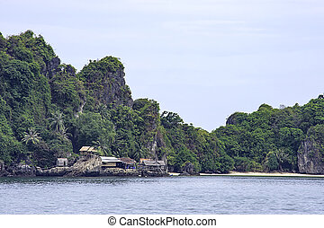 Wooden houses built on rocks in the koh Maphrao at Chumphon in Thailand.