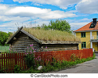 Wooden houses in Sigtuna streets (Sweden)