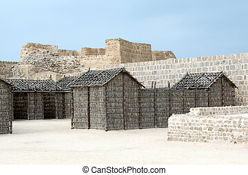 Wooden houses inside fort Bahrein near Manama city