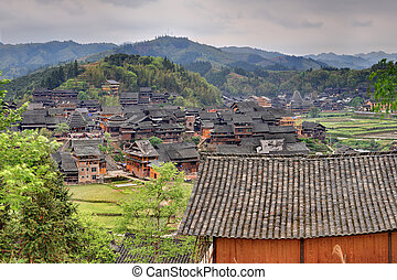 Wooden houses of farmers in the mountain village...