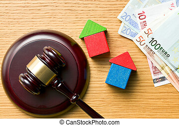wooden houses with money and judge gavel