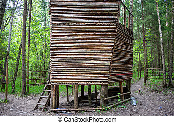 Wooden hut from a log in the forest
