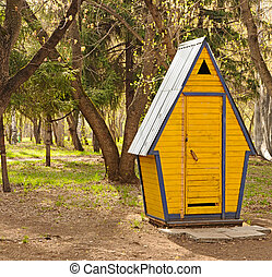 Wooden hut in the forest
