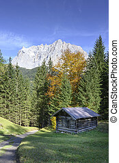 wooden hut shack at austrian alps in fall front of wetterstein mountains