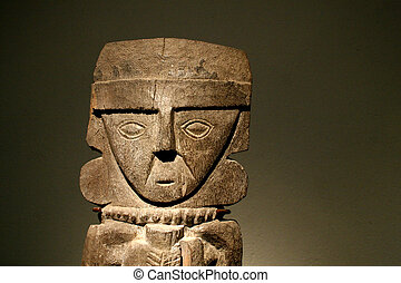 Wooden Inca Statue in Cuzco Peru in front of plain background